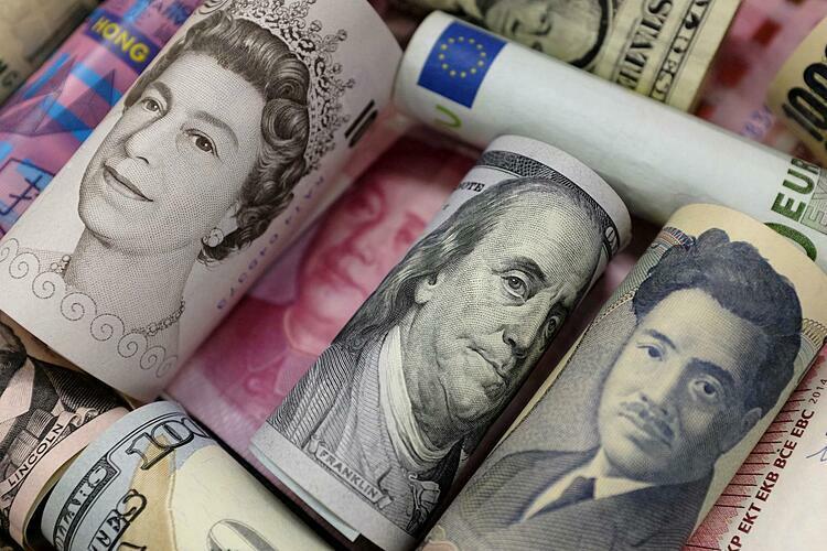 Tiền tệ các nền kinh tế trên thế giới. Ảnh: Reuters