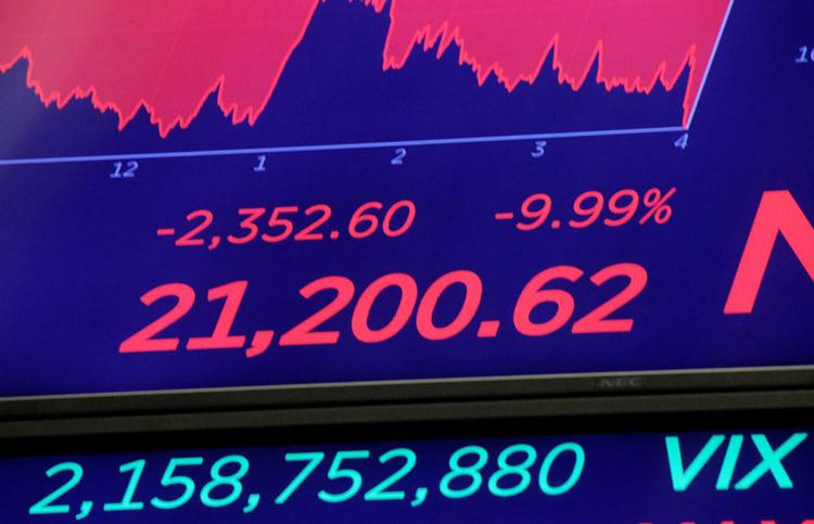 Màn hìnhtrênSàn giao dịch chứng khoán New York (NYSE) sau khi kết thúc phiên giao dịch 12/3 tại New York, Mỹ. Ảnh: Reuters.