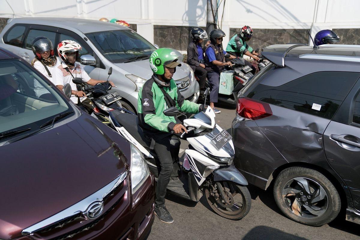 Tài xế Gojek trên đường phố tại Indonesia. Ảnh: Bloomberg