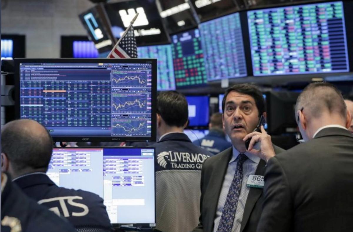 Nhân viên giao dịch trên sàn chứng khoán New York ngày 20/3. Ảnh: Reuters