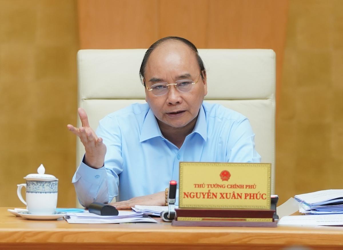 Thủ tướng Nguyễn Xuân Phúc chủ trì cuộc họp Ban chỉ đạo điều hành giá ngày 21/4. Ảnh: VGP