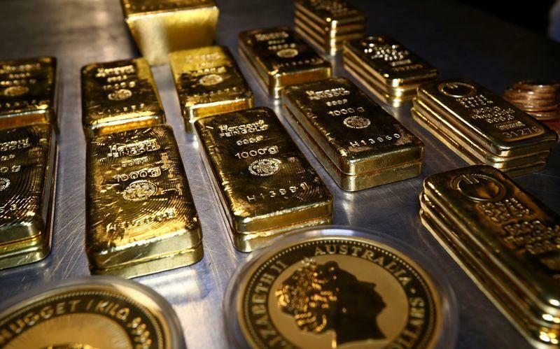 Các thỏi vàng và tiền xu trong phòng ký gửi an toàn của Pro Aurum tại Munich, Đức. Ảnh: Reuters.