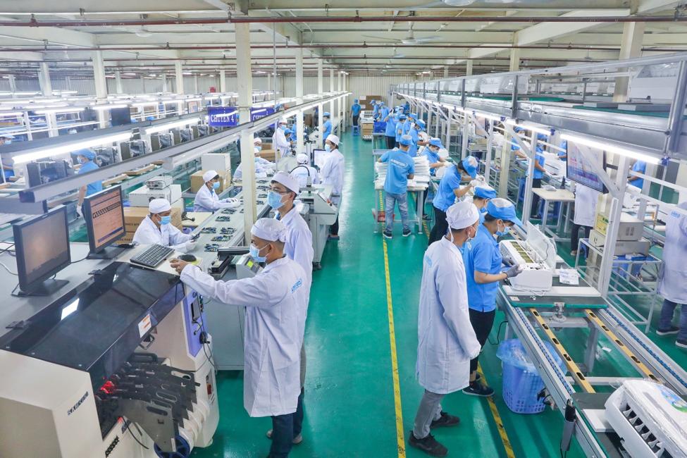 Bên trong dây chuyền lắp ráp, sản xuất máy lạnh của Asanzo tại khu công nghiệp Vĩnh Lộc, quận Bình Tân, TP HCM.Ảnh:Hữu Khoa.