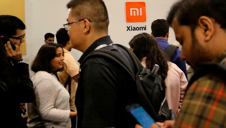 Người tham gia sự kiện ra mắt điện thoại mới của Xiaomi ở Bangalore (Ấn Độ). Ảnh: AP