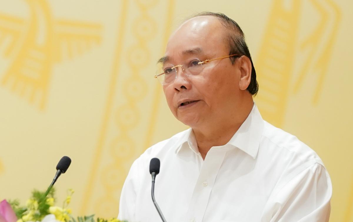 Thủ tướng Nguyễn Xuân Phúc phát biểu khai mạc hội nghị Chính phủ với các địa phương, sáng 2/7. Ảnh: VGP