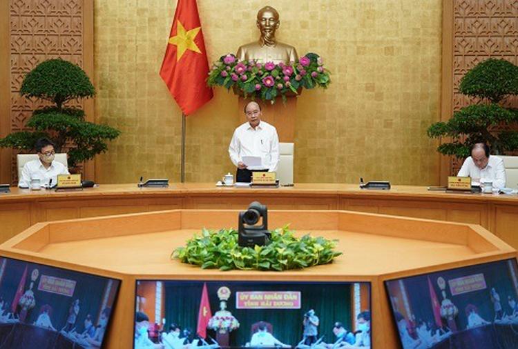 Thủ tướng Nguyễn Xuân Phúc chủ trì hội nghị đôn đốc, tháo gỡ khó khăn giải ngân đầu tư công, ngày 21/8. Ảnh: VGP