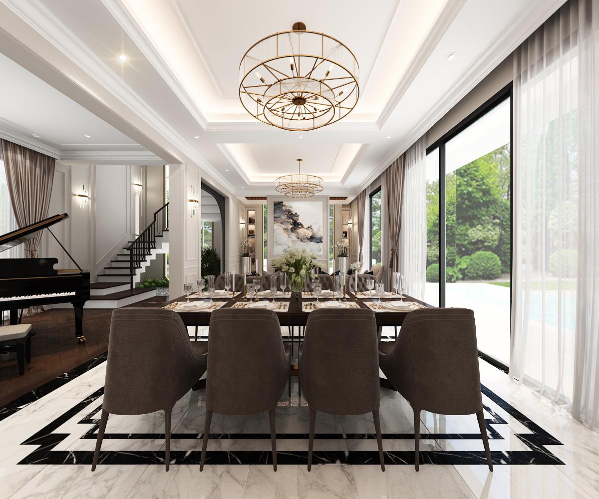 Không gian tầng trệt được thiết kế theo một trục đối xứng từ sảnh đón, phòng khách bàn ăn vào tới bếp kết hợp với hệ khung cửa kính cao bắt trọn view hồ bơi bên ngoài mang lại cảm giác kiến trúc và nội thất không có khoảng cách. Hồ bơi được bố trí theo chiều dọc khu đất, là điểm nhấn cảnh quan chính cho không gian phòng khách bàn ăn và khu bếp.