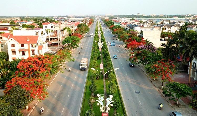 Đường Phạm Văn Đồng nối trung tâm thành phố với khu du lịch Đồ Sơn. Ảnh: Giang Chinh.