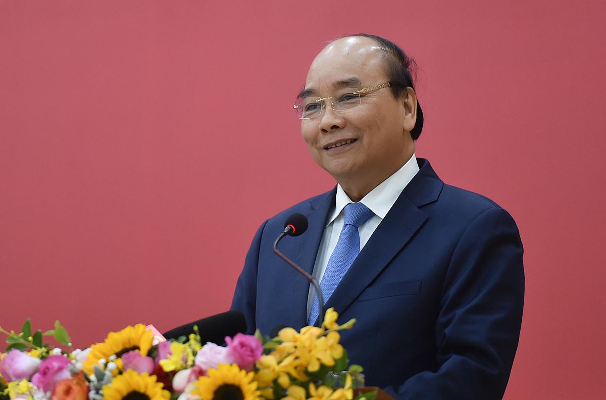Thủ tướng Nguyễn Xuân Phúc tại hội nghị Bộ Xây dựng chiều 26/12. Ảnh: VGP/Quang Hiếu.