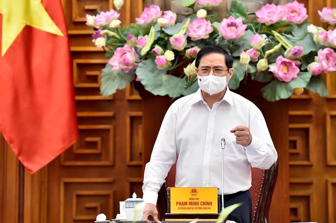 Thủ tướng Phạm Minh Chính trong buổi làm việc với Bộ Xây dựng ngày 18/5. Ảnh: VGP.