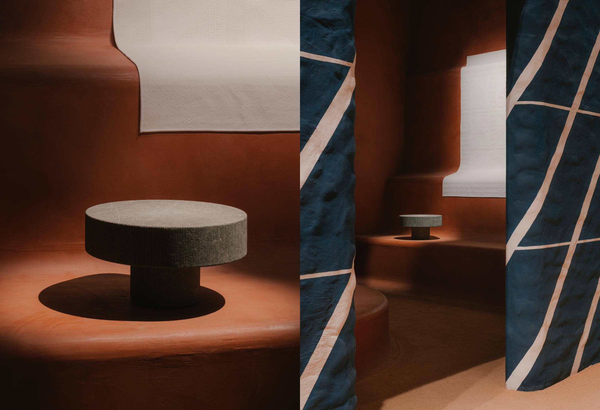 Bàn đá xanh Lignage d'Hermès đến từ Hainaut, Bỉ, được thiết kế bởi Studio Mumbai. Thiết kế kể về cuộc gặp gỡ giữa những nguyên liệu thô mộc và kỹ nghệ chế tác tinh tế. Vật liệu tạo nên chiếc bàn ban đầu có màu đen tuyền, sau đó dần chuyển sang sắc trắng trong quá trình khắc từng vạch thẳng nhằm tạo thành bề mặt rực sáng trên nền đá đen.