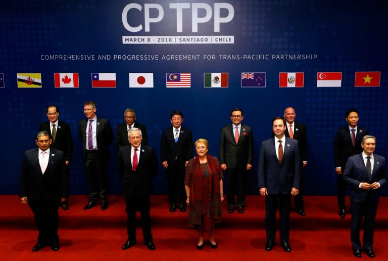 Đại diện 11 nước thành viên chụp hình lưu niệm tại buổi ký kết CTPP ở Santiago, Chile ngày 8/3/2018. Ảnh: AFP