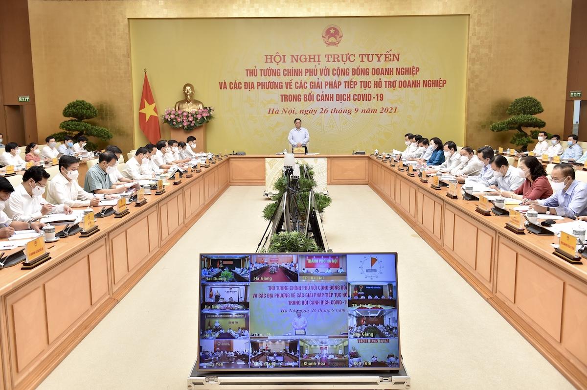 Thủ tướng chủ trì hội nghị đối thoại trực tuyến với cộng đồng doanh nghiệp, sáng 26/9. Ảnh: VGP